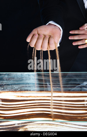 Man creating sand painting - Stock Photo