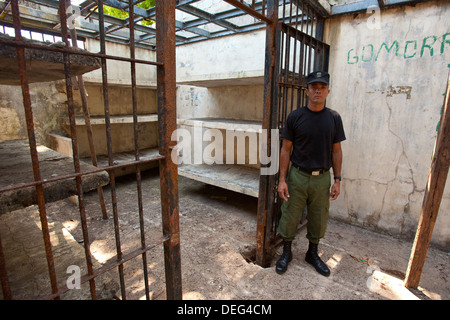 Police officer from the Panama police force outside a cell in the old prison at Isla de Coiba, Pacific coast, Republic - Stock Photo