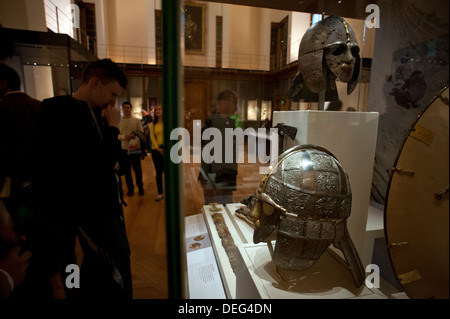 The British Museum, London, England. 9-2013 Sutton Hoo Anglo Saxon replica Helmet in foreground with remains of - Stock Photo