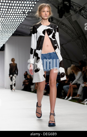 A model wears a design created by Marques'Almeida during London Fashion Week Spring/Summer 2014. - Stock Photo