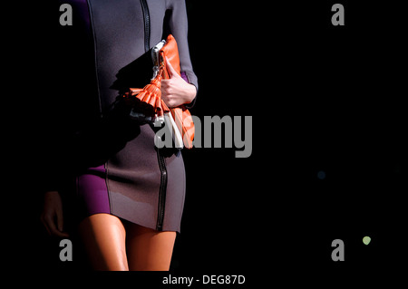 A model wears an accessory created by Anya Hindmarch during London Fashion Week Spring/Summer 2014. - Stock Photo