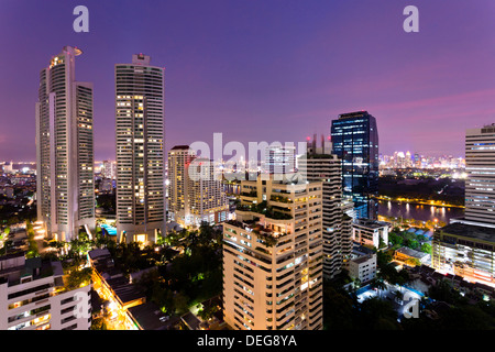 High rise buildings of Bangkok at night from Rembrandt Hotel and Towers, Sukhumvit 18, Bangkok, Thailand, Southeast - Stock Photo