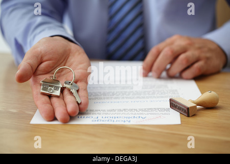 Handing over house keys - Stock Photo