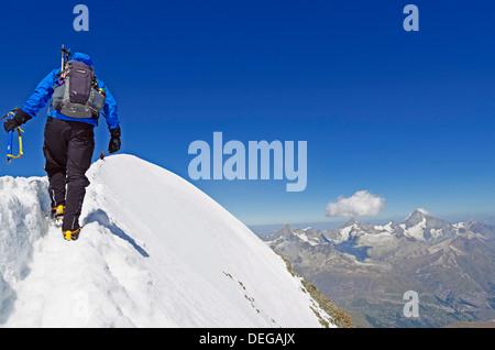 Climber on Breithorn mountain, 4164m, Zermatt, Valais, Swiss Alps, Switzerland, Europe - Stock Photo