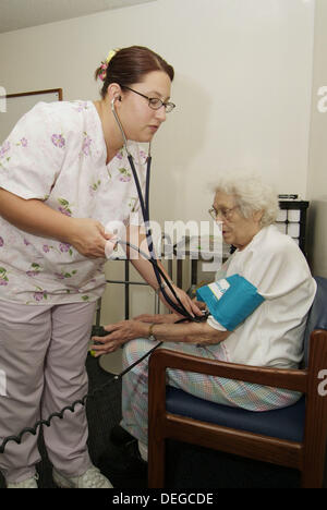Senior 85 year old female has medical check up with doctor physician - Stock Photo