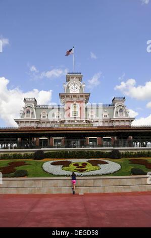 Train Station at Entrance to Walt Disney Magic Kingdom Theme Park Orlando Florida Central with Mickey Mouse flower - Stock Photo