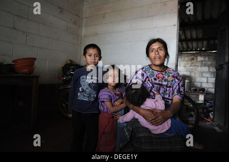 Guatemala indigenous family in Chuk Muk, Santiago Atitlan, Guatemala. - Stock Photo