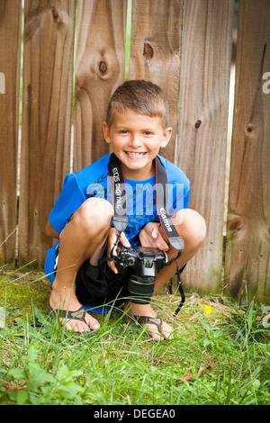 boy holding camera - Stock Photo