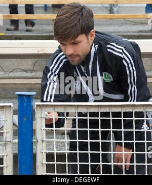 Diego Ribas da Cunha of VfL Wolfsburg paints the fence of the TSG Calbe Heger stadium in Calbe, Germany, 18 September - Stock Photo