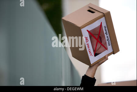 Boxes that were filled with signatures are held into the air in front of the Chancellery in Berlin to raise awareness - Stock Photo