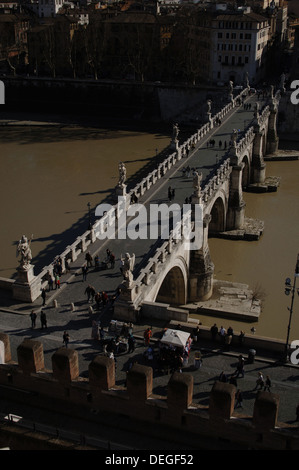 Italy. Rome. People crossing Saint Angelo Bridge (1668-1671) over the Tiber river. Aerial view. - Stock Photo