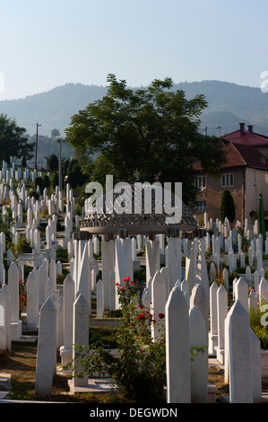 Gravestone of 1st president of B&H Alija Izetbegovic, Kovaci war cemetery, Sarajevo, capital of Bosnia and Herzegovina, - Stock Photo