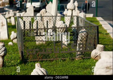 Tomb of 1st president of B&H Alija Izetbegovic, Kovaci war cemetery, Sarajevo, capital of Bosnia and Herzegovina, - Stock Photo