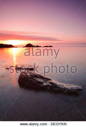 Rising sun at Cabo de Palos, Murcia, Spain - Stock Photo