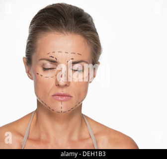 Portrait of woman with plastic surgery marks on face - Stock Photo