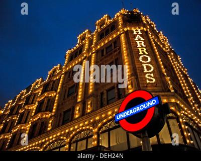 Harrods Department Store at night showing London Underground sign,  Knightsbridge, Royal Borough of Kensington and - Stock Photo