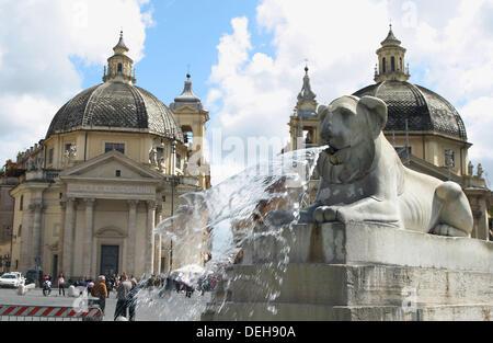 Piazza del Popolo. Obelisco Flaminio and marble lion fountain of Valadier with the twin churches of Santa Maria - Stock Photo