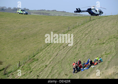 Kent Air Ambulance attending the scene of a paraglider crash, Mount Caburn, Lewes East Sussex - Stock Photo