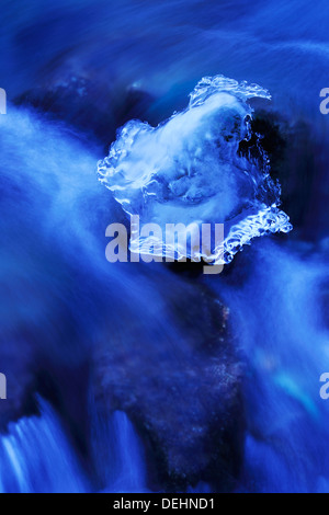 Detail from a waterstream with ice in winter. - Stock Photo
