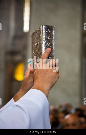 Close-up of a priest's hands holding a Bible, St. Peter's Basilica, Vatican City, Rome, Lazio, Italy - Stock Photo