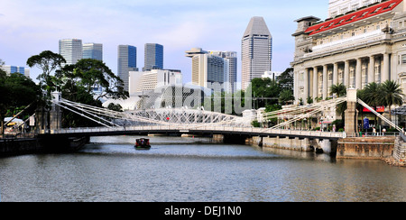 Sightseeing along Singapore River - The Cavenagh Bridge - Stock Photo