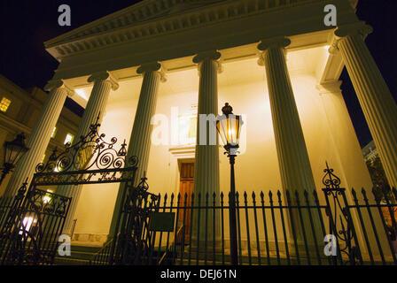 Night scene of Hibernian Hall on Meeting Street in the historic district of Charleston, South Carolina - Stock Photo
