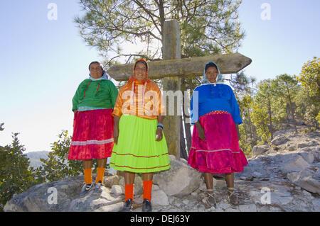 Tarahumara Indian women wearing their colorful native costumes, Copper Canyon near San Rafael, Mexico - Stock Photo