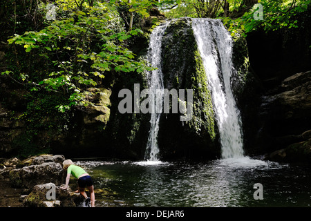Young boy exploring the delights of Janet's Foss, Malhamdale, Yorkshire Dales National Park, England - Stock Photo
