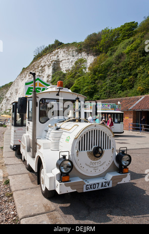 The Dotto Land Train runs along the promenade in the English seaside resort of Eastbourne during the summer months. - Stock Photo