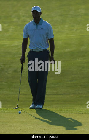 Aug. 21, 2013 - Jersey City, New Jersey, U.S - August 21, 2013: Tiger Woods (USA) casts a shadow as he addresses - Stock Photo