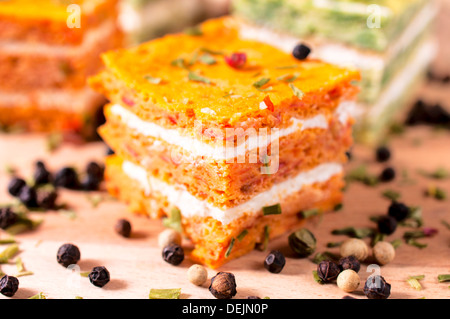 Selective focus in the middle of carrot appetizer with cream cheese - Stock Photo