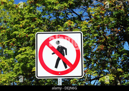 A no pedestrian crossing sign in a quiet neighborhood - Stock Photo