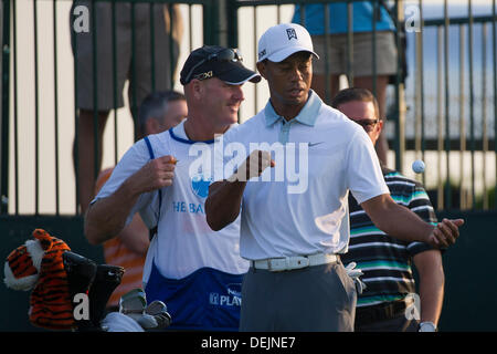 Aug. 21, 2013 - Jersey City, New Jersey, U.S - August 21, 2013: Tiger Woods (USA) watches the ball after he flips - Stock Photo