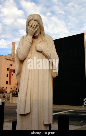 Weeping Jesus statue near the Oklahoma City bombing memorial. - Stock Photo