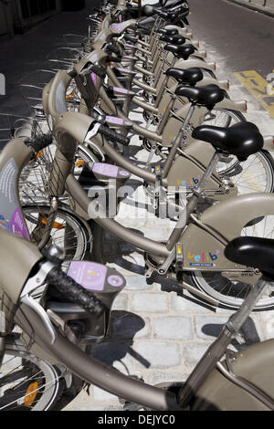 France. Paris. A closed up view of bicycles in a ´Velib´ bicycle station in the street of Paris. ´Velib´ is a new - Stock Photo