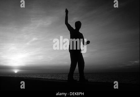 Silhouette of a fisherman on the Malecon in Havana - Stock Photo