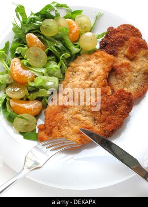 Schnitzel with grapes and mandarin salad - Stock Photo