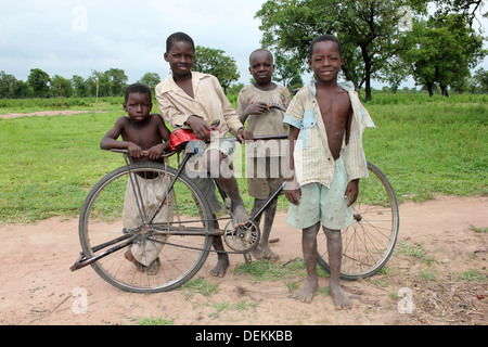 Ghanaian Boys Of The Gonja Ethnic Group With Bicycle - Stock Photo
