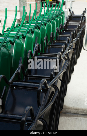 stacked rows of new builders wheelbarrows - Stock Photo