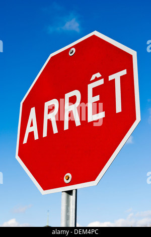 French stop sign 'arrêt' in Montréal, Québec, Canada. - Stock Photo