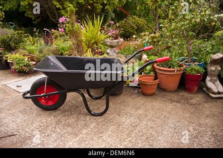 Empty Wheelbarrow In A Cottage Flower Garden - Stock Photo