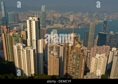 View across the skyscrapers in Central District and the Victoria Harbour to Kowloon, Hong Kong - Stock Photo