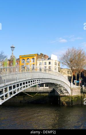 Hapenny Bridge in Dublin Ireland - Stock Photo