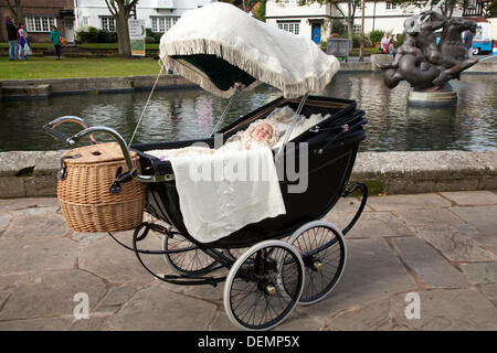 Port Sunlight, Wirral, UK.  21st September, 2013. a Wilson Treasure Cot, an International Vintage Pram and Doll - Stock Photo