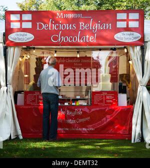 Port Sunlight, Wirral, UK.  21st September, 2013. Buying Belgian Chocolate at Port Sunlight Village annual Festival - Stock Photo