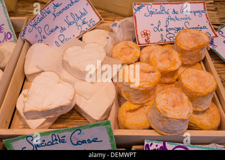 Specialty regional cheeses on sale at the Friday Richard Lenoir market, Paris, France - Stock Photo