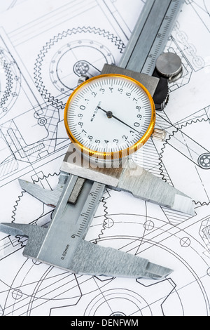 Metal vernier caliper on technical drawing - Stock Photo