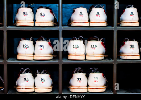 rack with shoes for bowling in different sizes - Stock Photo