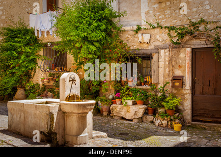 Water fountain and stone basin in medieval town of St. Paul de Vence, Provence France - Stock Photo