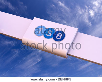 New TSB bank logo sign following split from LloydsTSB superimposed on blue sky. - Stock Photo